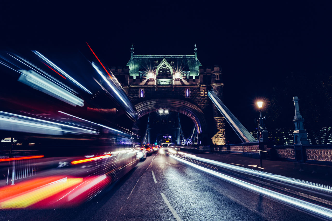 illuminated, transportation, architecture, night, motion, long exposure, blurred motion, built structure, speed, bridge - man made structure, city, road, bridge, light trail, travel, the way forward, travel destinations, mode of transportation, direction, no people, outdoors