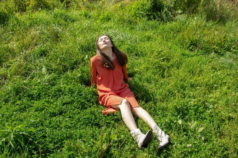 Portrait of smiling young woman on grass