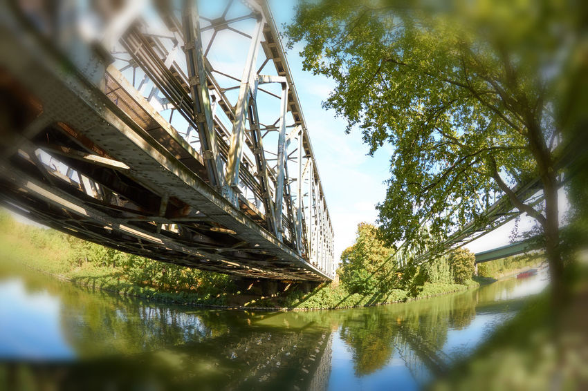 Railway Bridge Architecture Bridge Bridge - Man Made Structure Built Structure Connection Day Low Angle View Nature No People Outdoors Plant Railway Railway Bridge Reflection River Sky Transportation Tree Water Waterfront