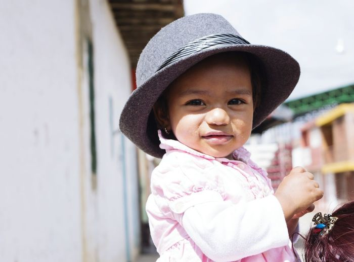 Portrait of smiling baby wearing hat