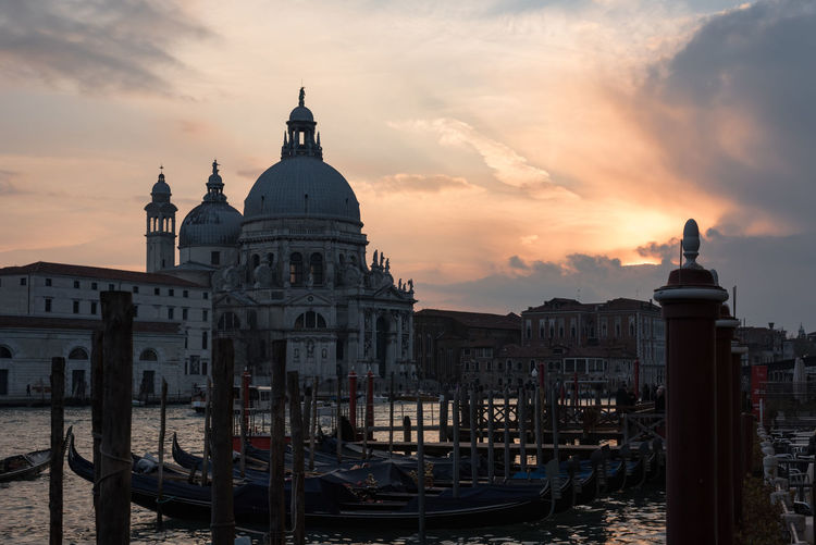Sunset over St. Mary of Health in Venice Italy Church Panorama Venice, Italy Architecture Building Exterior Built Structure Canal Cloud - Sky Dome Gondola - Traditional Boat History Italy Nature Nautical Vessel Outdoors Place Of Worship Religion Sky Spirituality St Mary Of Health Sunset Travel Destinations Venice Water