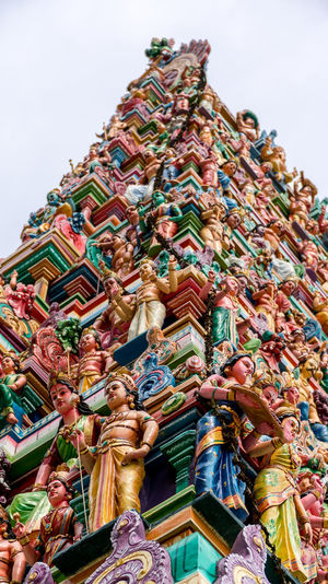 Gopuram (tower) of Sri Subramaniar Hindu Temple Architecture Art And Craft Building Exterior Built Structure Close-up Day Gopuram Hindu Temple Low Angle View Multi Colored No People Outdoors Place Of Worship Religion Sculpture Sky Spirituality Statue Tower