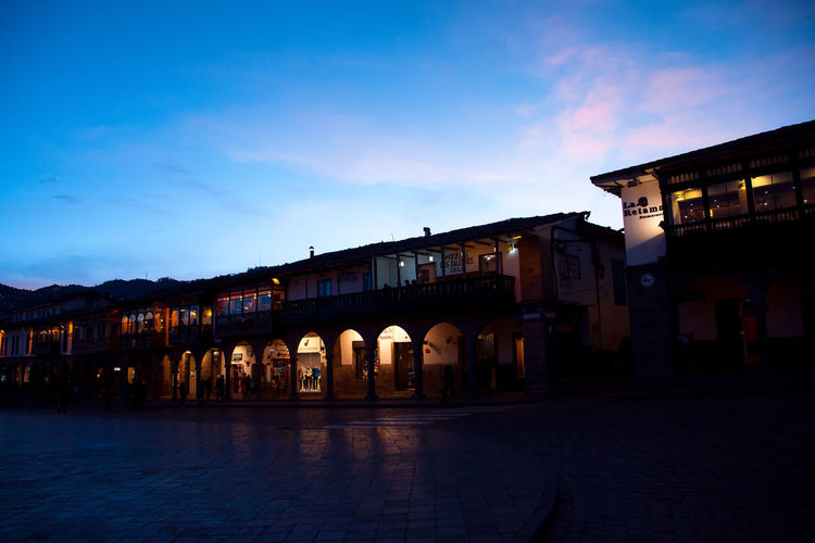 Cusco Noche Cielo Plaza Arcades Arcadas Colonial Architecture Built Structure Building Exterior Sky Building City Dusk Nature Cloud - Sky Illuminated Sunset Night Street No People Arch Outdoors History Blue The Past