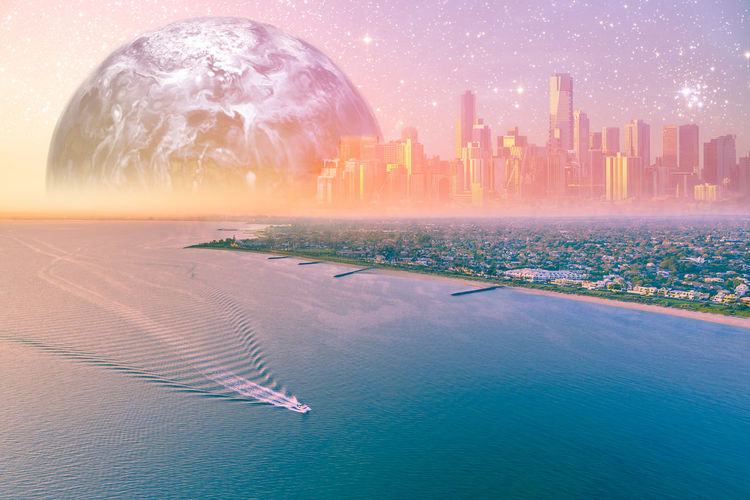 Digital composite image of buildings and sea in city