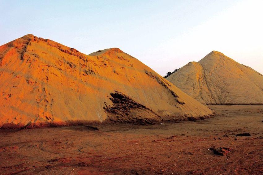 mountain? sandpile. Arid Climate Arid Landscape Landscape Non-urban Scene Outdoors Remote Rough Sand Sand Dune Tranquil Scene Tranquility