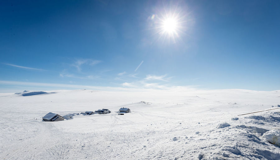 Snow Winter Cold Temperature Sky Sun Scenics - Nature Sunlight Beauty In Nature Tranquil Scene Mountain Tranquility Nature Day Non-urban Scene Sunny Environment White Color Lens Flare Landscape Snowcapped Mountain Bright No People Outdoors