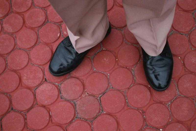 Overhead view of man standing on tiled floor