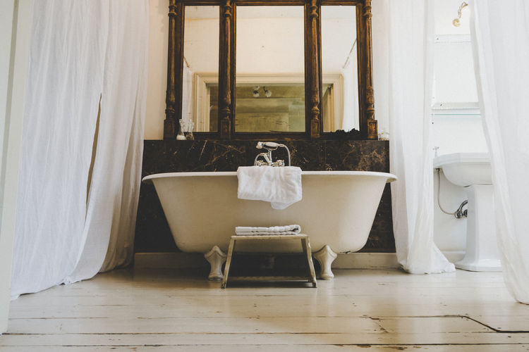 The modern bathtub. Indoors  Seat Curtain Chair Domestic Room No People White Color Home Flooring Absence Home Interior Window Architecture Bathroom Furniture Table Hardwood Floor Wood Empty Day Luxury