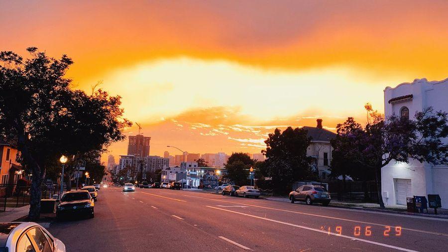 City street against orange sky
