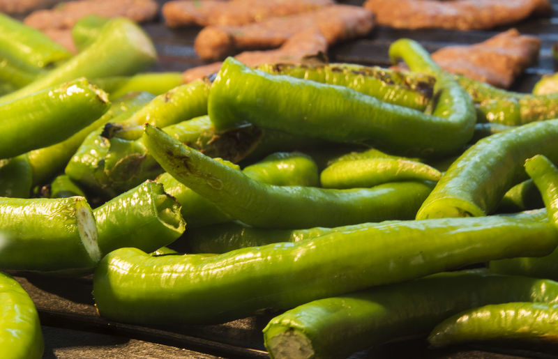 baked in the fire green hot peppers Abundance Baked Close-up Consumerism Display Fire Food Food And Drink For Sale Freshness Full Frame Green Color Healthy Eating Heap Hot Market Market Stall Organic Peppers Retail  Retail Display Selective Focus Selling Still Life Vegetable