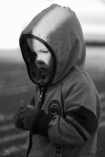 Close-up of boy wearing hooded shirt