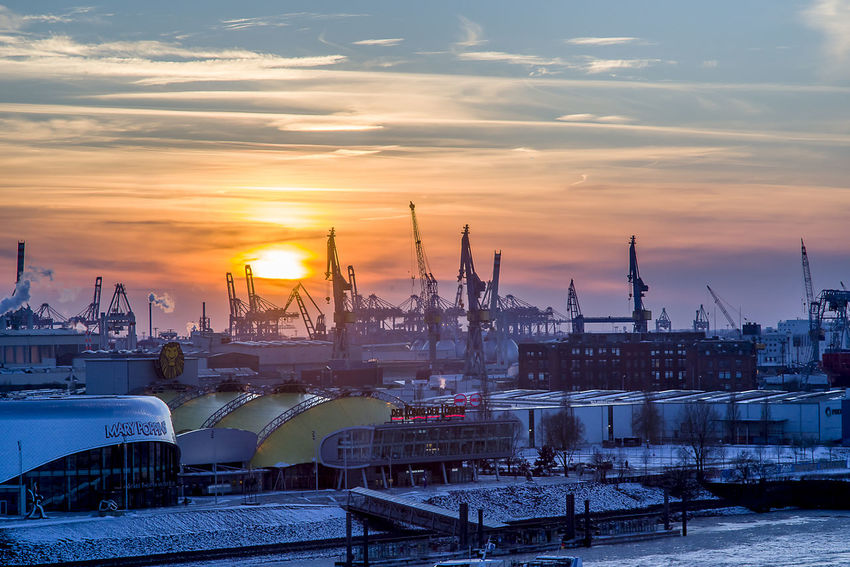 Architecture Building Exterior Built Structure Cityscape Cloud - Sky Cold Temperature Commercial Dock Freight Transportation Harbor Industry Nautical Vessel Shipping  Shipyard Sky Sunset Winter
