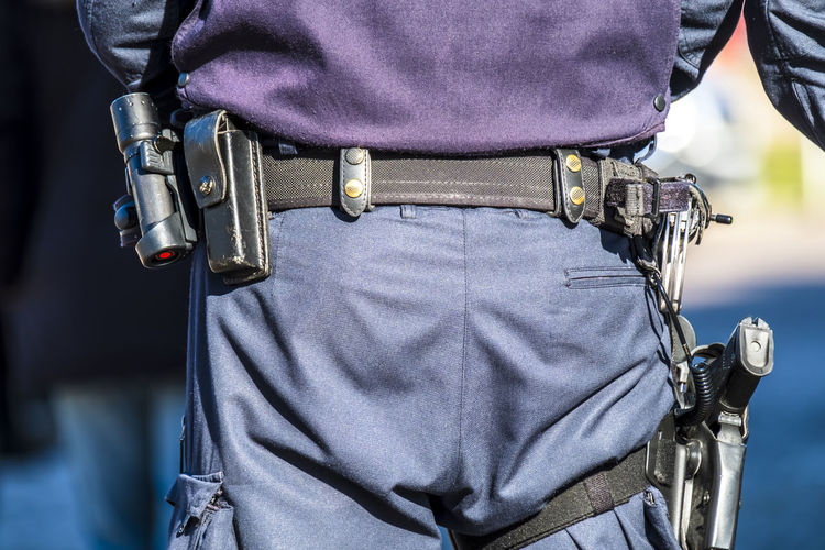 Rear View Midsection Of Police With Weapons