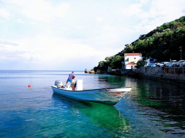 People People Fishing Blue Water Blue Sky Blue Water People In The Boat Green Water Water Nautical Vessel Sea Beach Sky Cloud - Sky Building Exterior Landscape Fishing Boat Rowboat Calm Jet Boat Waterfront Wake - Water Boat Fishing Industry Moored Outrigger