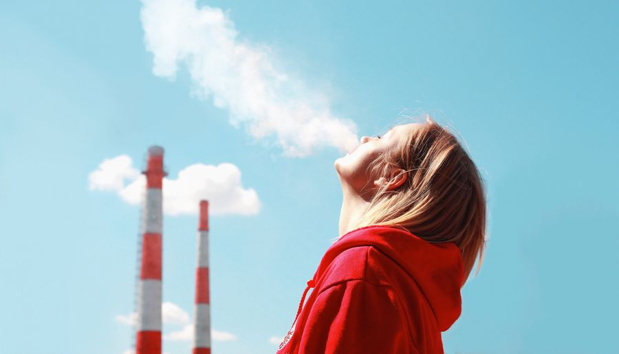 Close-up of woman smoking against sky