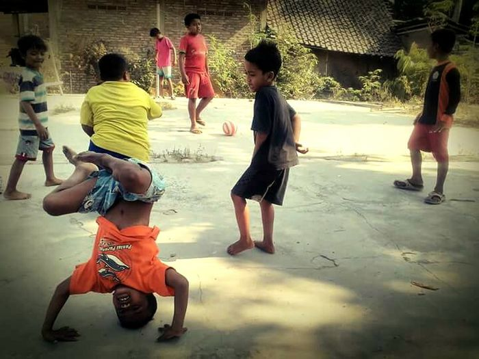 """if the kids are united"" Kidsphotography Indonesiakids Village Life Yogyakarta Headstand INDONESIA Kids Being Kids"