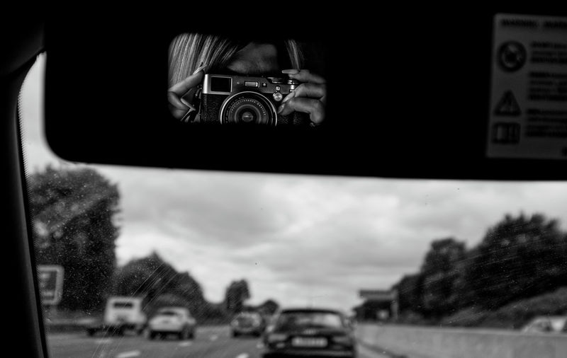 Reflection of camera in car mirror