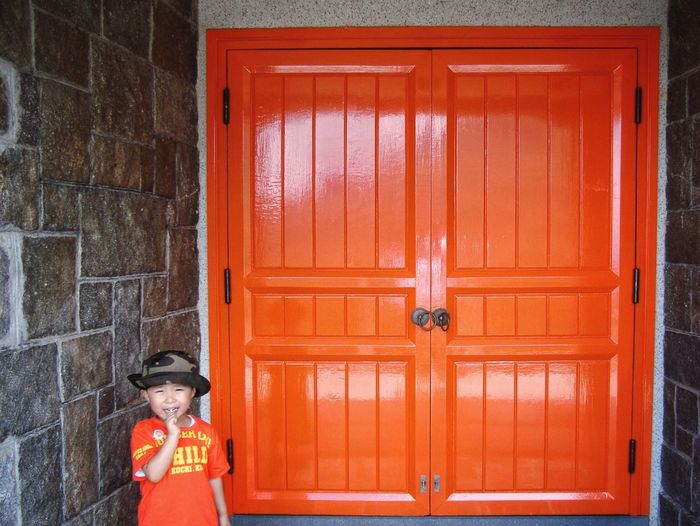 Full length of a red closed door