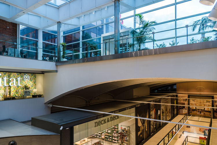 Interior view of shopping mall in Madrid Shopping Abc Serrano Architecture Building Built Structure Day Glass - Material Indoors  Interior Luxury Modern No People Office Plant Railing Reflection Shopping Mall Staircase Steps And Staircases Transparent Tree Window