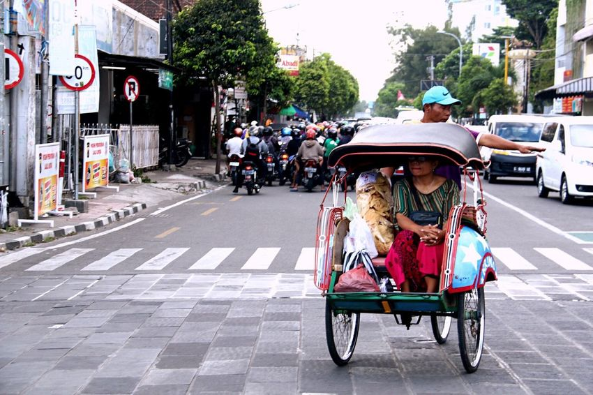 Transportation Street Mode Of Transport City Street Adult Outdoors Becak City Life City People Day Land Vehicle Retail  Motorcycle Road Adults Only Men Women Tree Real People Your Ticket To Europe