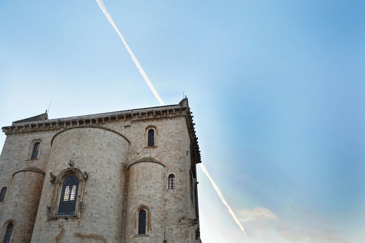 Trani cathedral with aircraft contrail Aircraft Contrails Architecture Beautiful Cathedral Beautiful Church Building Exterior Built Structure Churches Clear Sky Contrail Day EyeEm Best Edits EyeEm Best Shots EyeEm Gallery EyeEmBestPics Low Angle View No People Outdoors Romanic Romanic Windows Sky Sky And Clouds Sky And Sea Trani Trani Cathedral Trani Church Close Up Technology EyeEmNewHere