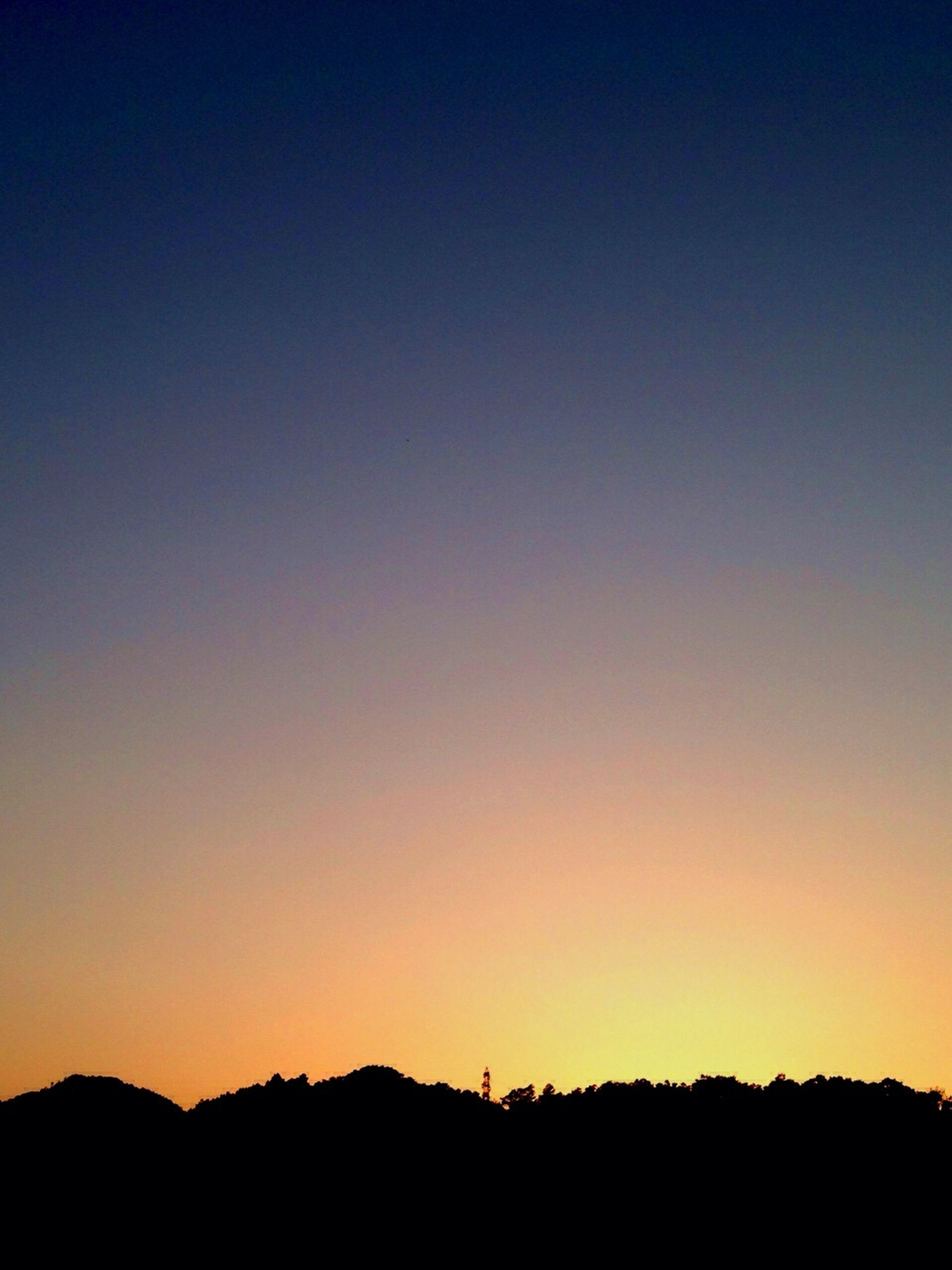 silhouette, copy space, sunset, clear sky, tranquil scene, scenics, tranquility, beauty in nature, landscape, mountain, nature, idyllic, dusk, blue, outline, mountain range, dark, outdoors, non-urban scene, orange color