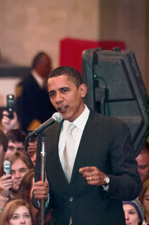 Barack Obama Crowds Obama Obama 2008 Speech Adult Adults Only Arts Culture And Entertainment Campaign Crowd Day Film Industry Indoors  Lifestyles Men Microphone People Photography Themes Presidential Campaign Smiling Stump Speech Suit Technology Two People Young Adult