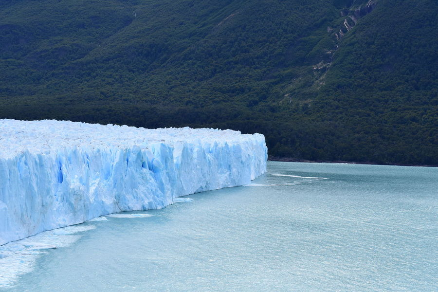 Argentina Beauty In Nature Cliff Cold Cold Temperature Day Geology Glaciar Glaciar Perito Moreno Ice Idyllic Lake Mountain Mountain Range Nature Outdoors Physical Geography Rock Rock - Object Landscapes With WhiteWall Rupture Scenics Tranquil Scene Tranquility Water