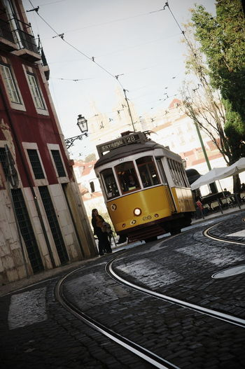 a cable car in the streets of Lisbon, Portugal Portugal Cable City Lissabon Mode Of Transport Public Transportation Street Tramway Transportation