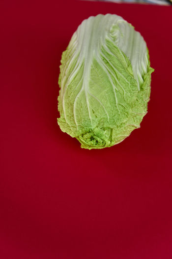 Chinakohl Chinese Cabbage Cabbage Close-up Colored Background Day Dieting Food Food And Drink Freshness Healthy Eating Healthy Lifestyle Indoors  No People Red Red Background Studio Shot Vegetable Vegetarian Food