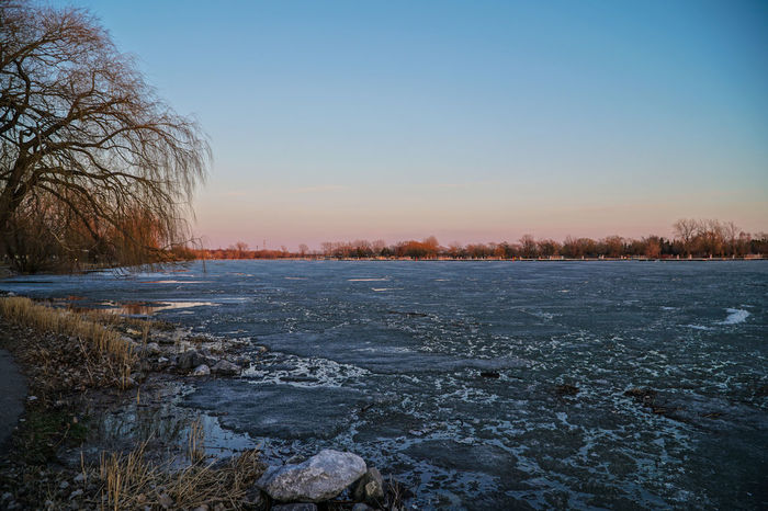 Lachine Lachine Canal Montreal Nature Bare Tree Beauty In Nature Branch Canada Canada Coast To Coast Clear Sky Cold Temperature Day Dusk Frozen Landscape Nature No People Outdoors Park Scenics Sky Snow Sunset Sunset Time Tranquil Scene Tranquility Tree Water Winter