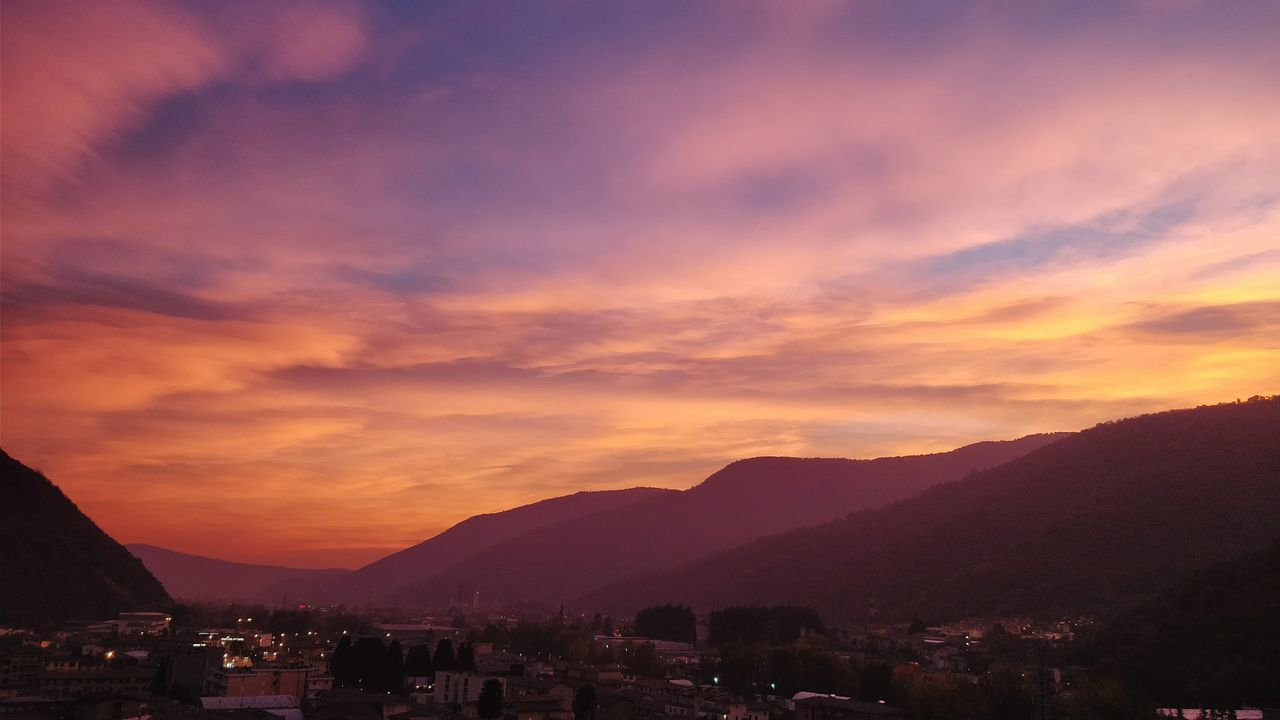 sunset, mountain, built structure, architecture, sky, building exterior, mountain range, beauty in nature, scenics, nature, cloud - sky, no people, outdoors, city, cityscape, day