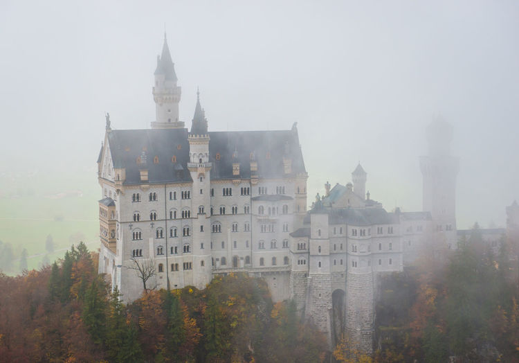 Neuschwanstein Castle with Autumn colors, Fussen, German Architecture Built Structure Fog Building Exterior Building Tree Nature History The Past Plant Sky No People Day Travel Destinations Outdoors Religion Tower Change City