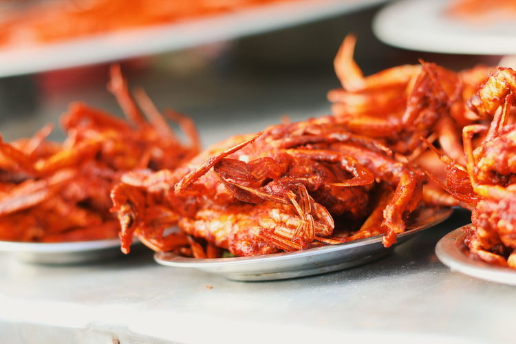 Close-Up Of Cooked Crabs In Plate On Table