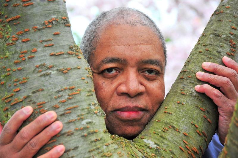 Portrait of man making tree trunk