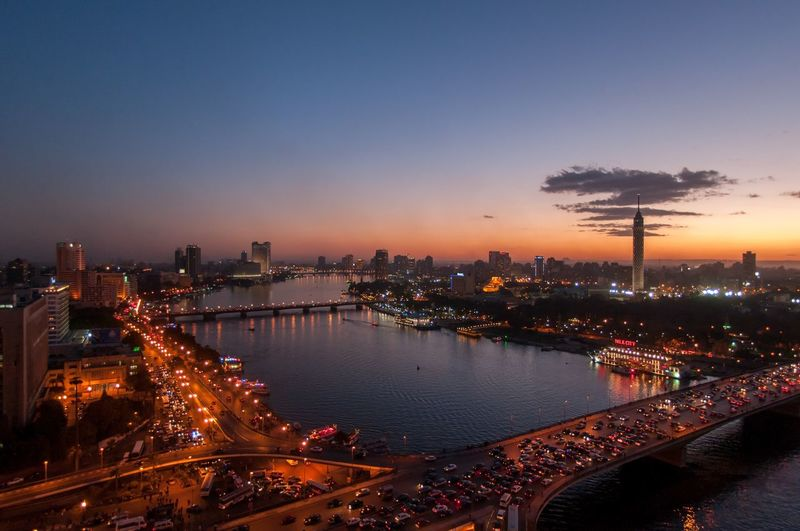 Cairo Egypt at night, aerial shot of the Nile Ariel Cairo River Nile Illuminated City Architecture Built Structure Building Exterior Night Sky Water Cityscape Travel Destinations Dusk