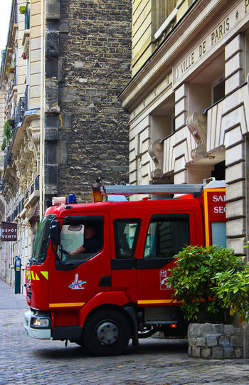 Accidents And Disasters Architecture Building City Day Fire Department Fire Engine Firefighter No People Outdoors Paris Red Sapeurspompiers Street Transportation