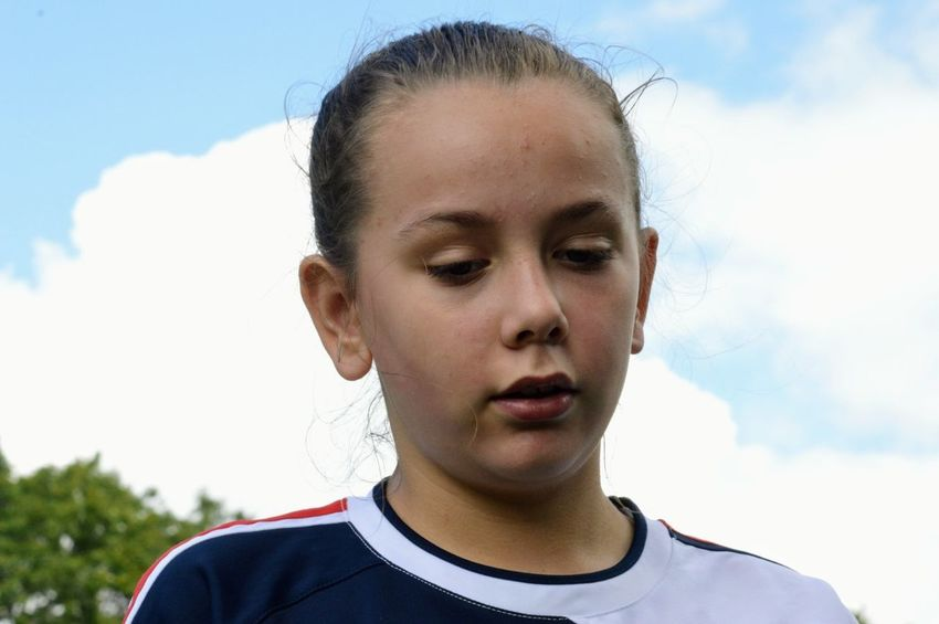 The Purist (no Edit, No Filter) The Week On EyeEm Soccergirl  Headshot Sky Serious Soccer Soccer Uniform Soccer Player Front View Cloud - Sky One Person Teenager Athlete Portrait Teenagers Only Sports Clothing Sports Uniform Sport Outdoors People Day Soccer Field Kids Of EyeEm Connected By Travel