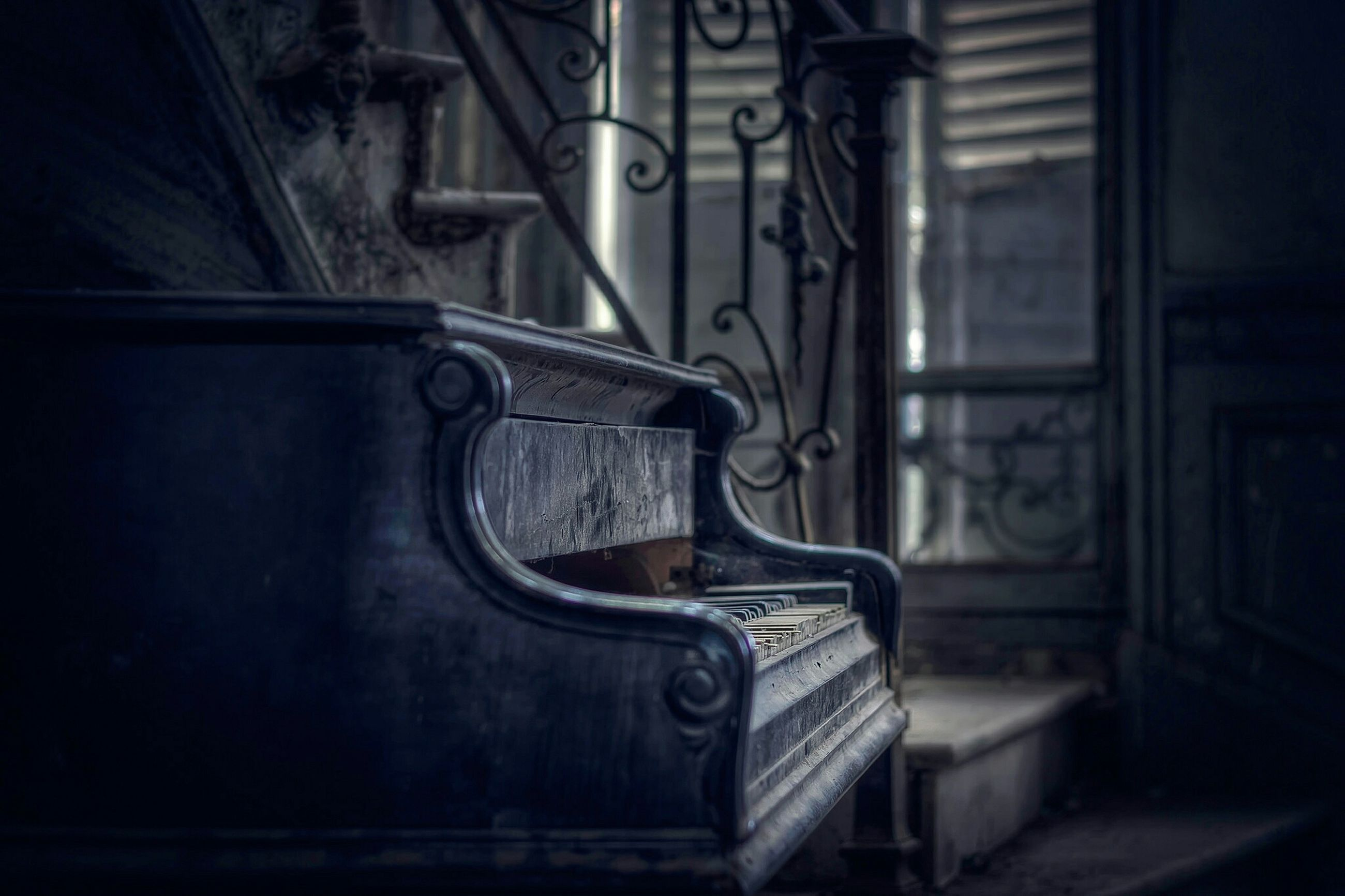 indoors, metal, close-up, focus on foreground, wood - material, door, no people, old, metallic, old-fashioned, wall - building feature, built structure, wooden, closed, railing, wood, day, home interior, sunlight, house