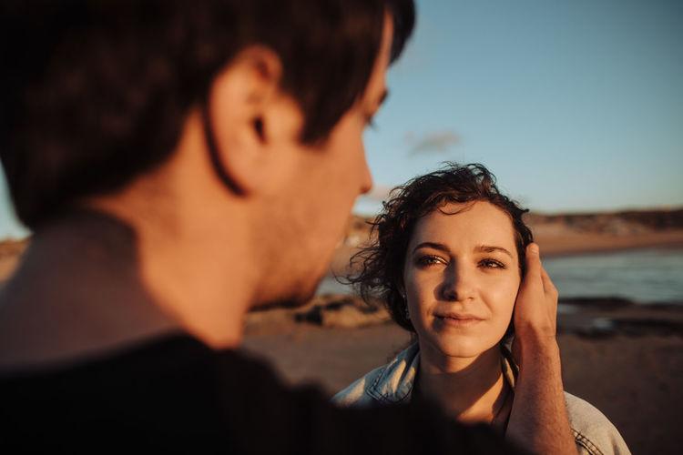 Portrait of couple against sky