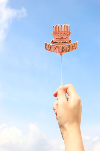 Human Hand Hand Sky Human Body Part One Person Holding Cloud - Sky Day Nature Low Angle View Sweet Food Real People Body Part Unrecognizable Person Blue Sweet Outdoors Lifestyles Temptation Finger Human Limb Happy Birthday! Birthday Party Party Time