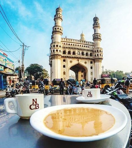Charminar Reflection In Irani Chai Old City Nimrah Cafe Irani Chai Hyderabad India NoEditNoFilter Architecture Monument Table Outdoors Daytime EyeEmNewHere