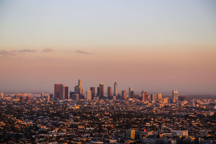 view of downtown Los Angeles at sunset Los Ángeles California Drone View Drone  North America Travel Destinations Travel Touristic Landmark Skyscrapers Suburbs Vacation Destination Iconic Landscape City Cityscape Urban Skyline Illuminated Modern Skyscraper Sunset Downtown District High Angle View Dusk Financial District  Office Building Exterior Tall - High Scenics Skyline Tourist Attraction  Urban Sprawl