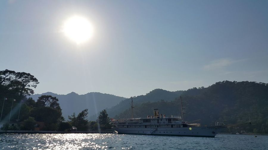 Ferry boat in sea against sky