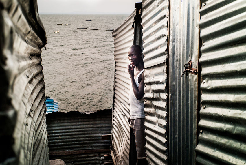 Migingo Island, Lake Victoria, Kenya Africa Corrugated Iron Documentary Photography Grey Day Horizon Over Water Huts Island Kenya Lake Lake View Metal Sheets Migingo Island Silver - Metal Slum Social Documentary Social Hotspot Streetphotography Village Life Water Wellblech