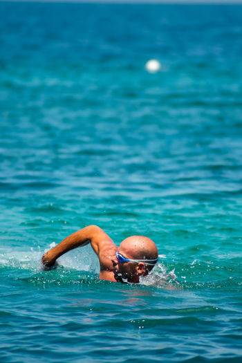 Man swimming on the sea