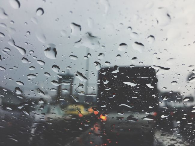 Drop Window Glass - Material Wet Water Rain Weather Rainy Season RainDrop No People Indoors  Focus On Foreground Day Close-up Full Frame Nature Sky Traffic Jam