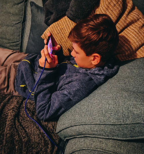 Boy holding phone at home
