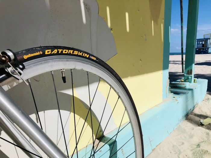 Low angle view of bicycle sign on wall