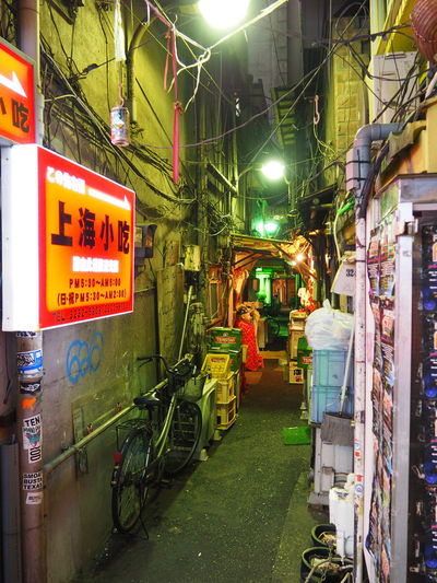 Architecture ASIA Bikes Building Exterior Cables And Wires Illuminated Japan Metropolis Narrow Street Night No People Outdoors Shinjuku Tokyo Tokyo Night Travel Destinations The Graphic City
